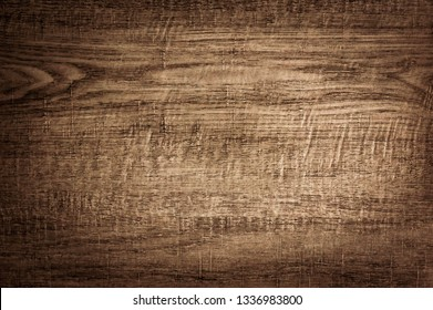 Wood background texture of board surface. Brown wooden grunge plank.