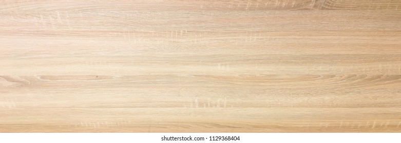 wood background texture, light weathered rustic oak. faded wooden varnished paint showing woodgrain texture. hardwood washed planks background pattern table top view