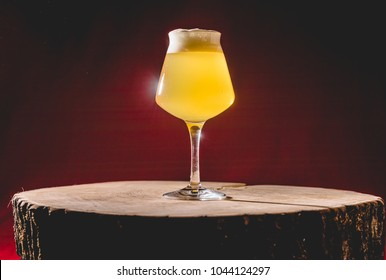 Wood Barrel Aged Lambic Beer in Teku Glass. Studio Shot.