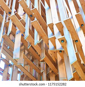 WOOD BARS CONCEPT STRUCTURE WITH    METAL PINS AND BOLTS JOINERY