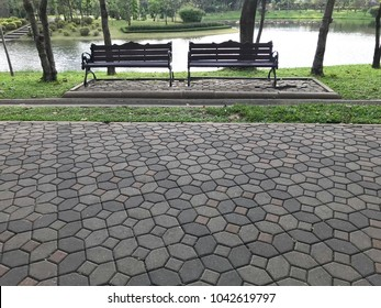 Wood bench in the park for relaxation, empty wooden seat in the garden