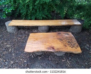 wood bench and table and mulch