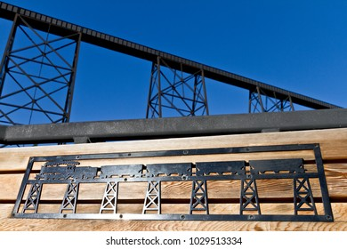 Wood bench with train in background