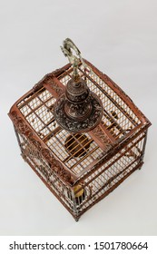 wood bird cage on white background,vintage cage carve with hand made for Red whiskered bulbul bird,art design of cage,shot from top view