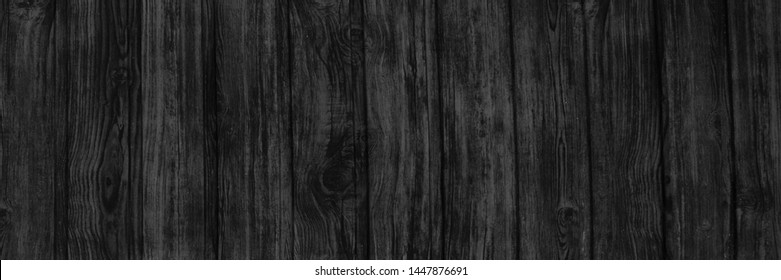 Wood black background texture surface with natural pattern. Wooden close up planks structure perfect for white copy space, web banner, poster, brochure, package and label design.