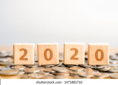 Wood block 2020 on Coin stack. Pension fund, 401K, Passive income. Business investment growth concept. Risk management. Budget 2020.