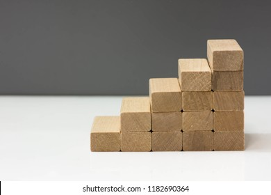 Wood block stacking as step stair.  Career path or business growth concept.