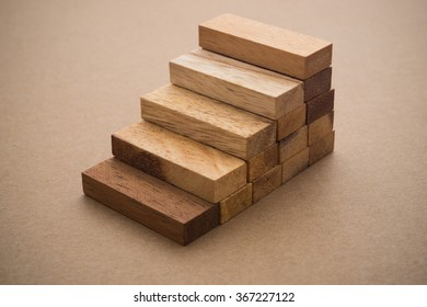 Wood block stacking as step stair with. Business concept for growth success process.