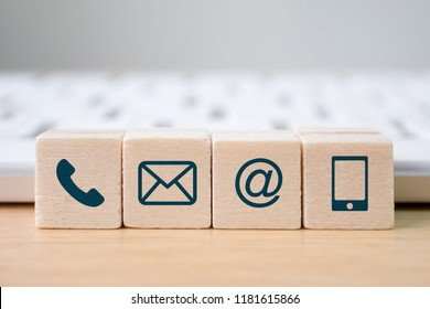 Wood block symbol telephone, mail, address and mobile phone. Website page contact us or e-mail marketing concept