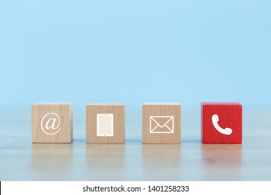 Wood block symbol telephone,mail,address and mobile phone.Website page contact us or e-mail marketing and Communications concept - Image