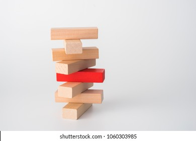 Wood block unstable staking. Business risk concept metaphor.