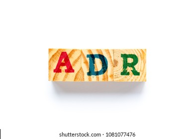 Wood block in word ADR (Abbreviation of adverse drug reaction) on white background