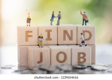 Wood block word FIND JOB and business man with copy space using as background  Choice of the best suited employee, HR, HRM, HRD, job recruiter concepts.