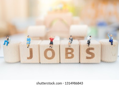 Wood block word JOBS and business man with copy space using as background Choice of the best suited employee, HR, HRM, HRD, job recruiter concepts.