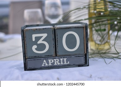 Wood blocks in box with date, day and month 30 April. Wooden blocks calendar