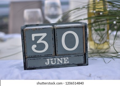 Wood blocks in box with date, day and month 30 June. Wooden blocks calendar