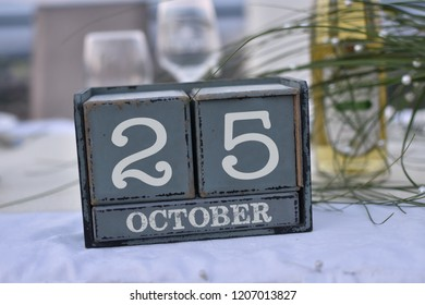 Wood blocks in box with date, day and month 25 October. Wooden blocks calendar