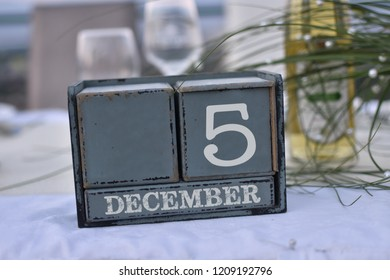 Wood blocks in box with date, day and month 5 December. Wooden blocks calendar