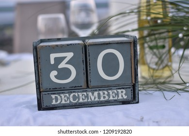 Wood blocks in box with date, day and month 30 December. Wooden blocks calendar