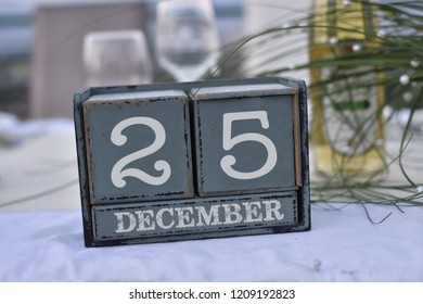 Wood blocks in box with date, day and month 25 December. Wooden blocks calendar