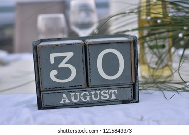 Wood blocks in box with date, day and month 30 August. Wooden blocks calendar