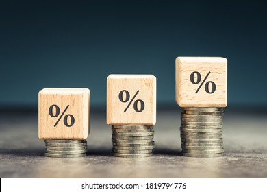 Wood blocks with percentage symbol on heap coins stair, increase percentage on increase money