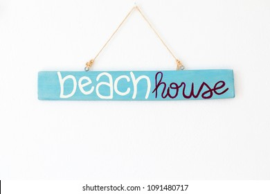 wood blue sign beach house on the white wall