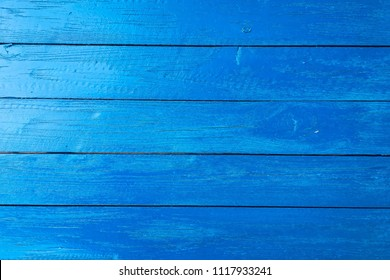 wood blue texture background, light weathered rustic oak. faded wooden varnished paint showing woodgrain texture. hardwood washed planks pattern table top view