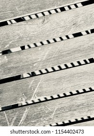 Wood board 2x4 slats with shadows behind on slant,  black and white background