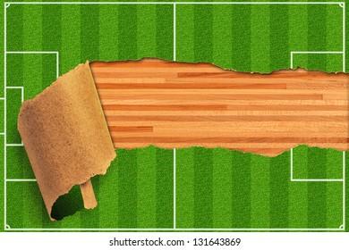 Wood board behind torn soccer field