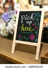 """Wood board with Text""""pick up here"""" decorated in coffee shop"""