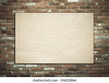 Wood board on brick wall.