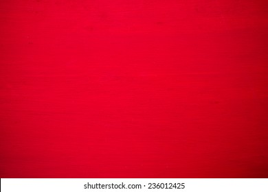 Wood board painted red for background.
