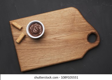 Wood board with wafles and chocolate spread