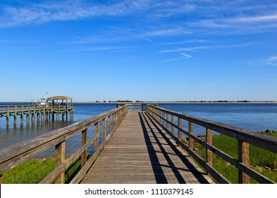 Wood boardwalk at Waterfront Park in Southport, North Carolina in the summer