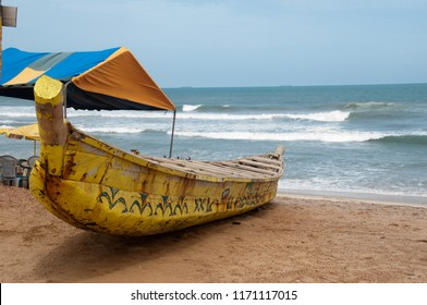 Wood boat on beach near Accra, Ghana