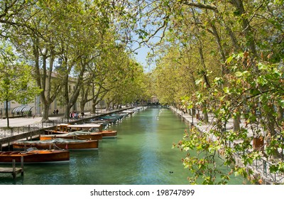 Wood boats on Annecy canal.