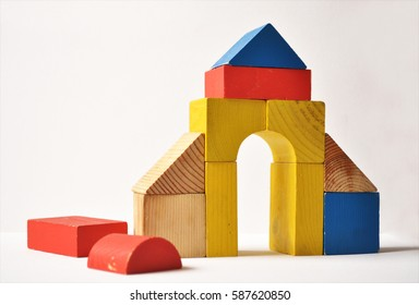 wood bricks building children's toys wooden cubes on a white background