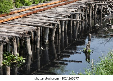 wood bridge cross the waste water in river , bad environtment concept