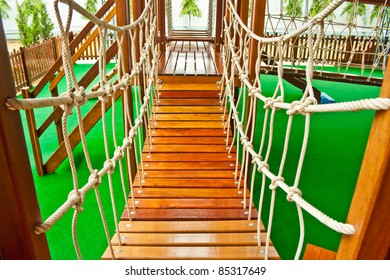 wood bridge at indoor playground