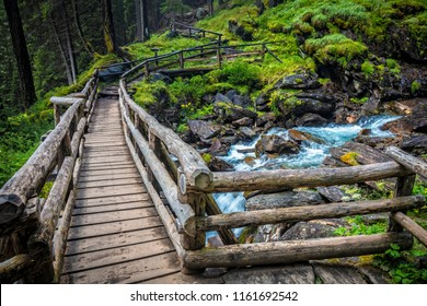wood bridge at saent waterfall trentino alto adige italy
