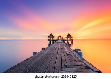Wood bridge at sunset light in sea