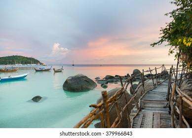 Wood bridge with sunset at pattaya beach in Koh Lipe Island