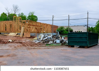 Wood Building frame at Multi-Family Housing Construction Recycling container trash and beam construction