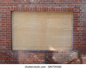 wood bulletin board and red brick wall
