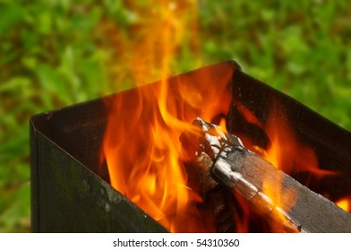 Wood burning in a barbeque grill