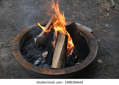 Wood burning camp fire summer