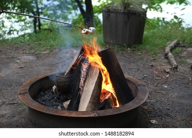 Wood burning camp flaming fire