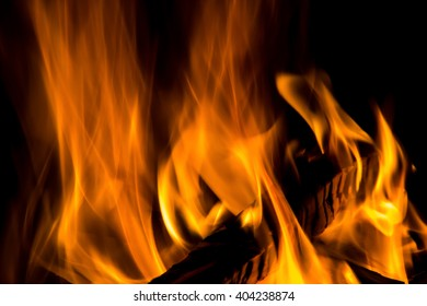 wood burning in a fire isolated on a black background