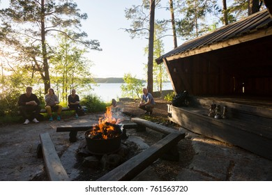 Wood Burning Firepit With Friends Relaxing In Forest